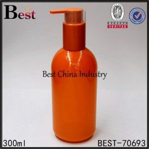 orange color plastic shampoo bottle with shampoo pump