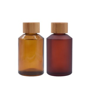 cosmetic amber glass bottle with bamboo cap