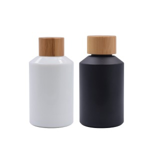 glass cosmetic bottle with bamboo cap